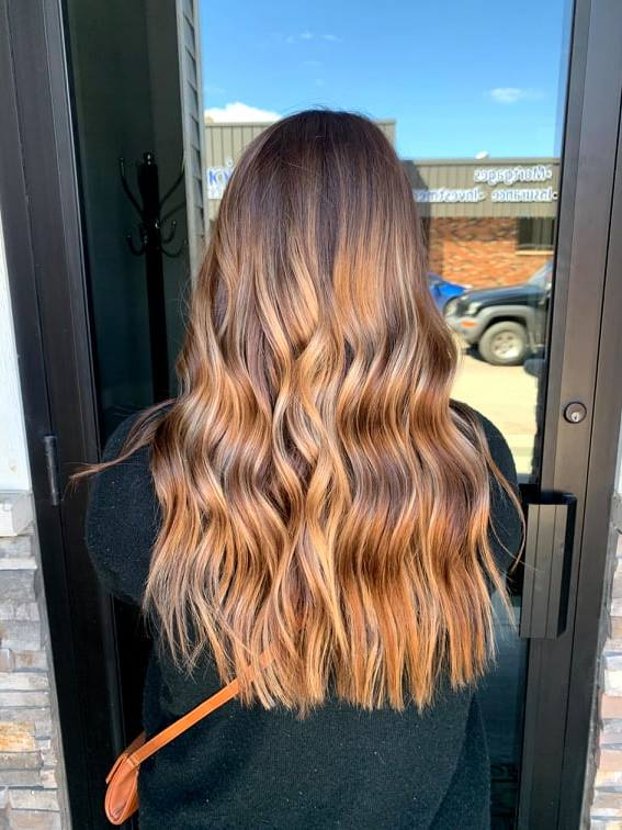A warm-toned, soft ombre highlighting technique.
