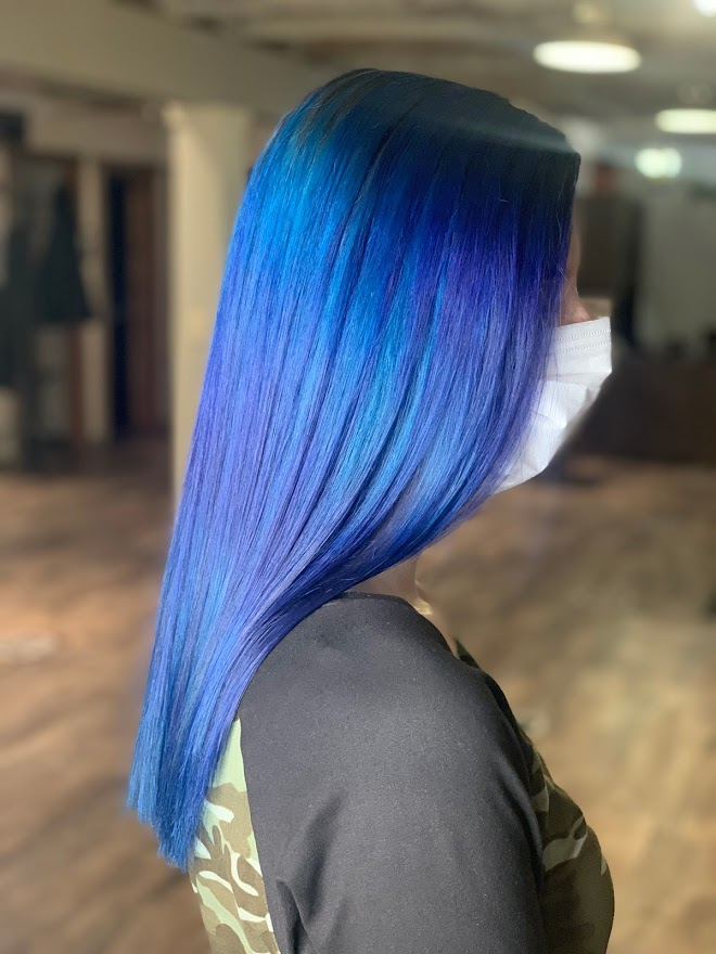 A blue fashion hair color on a client at Mill Pond Salon.